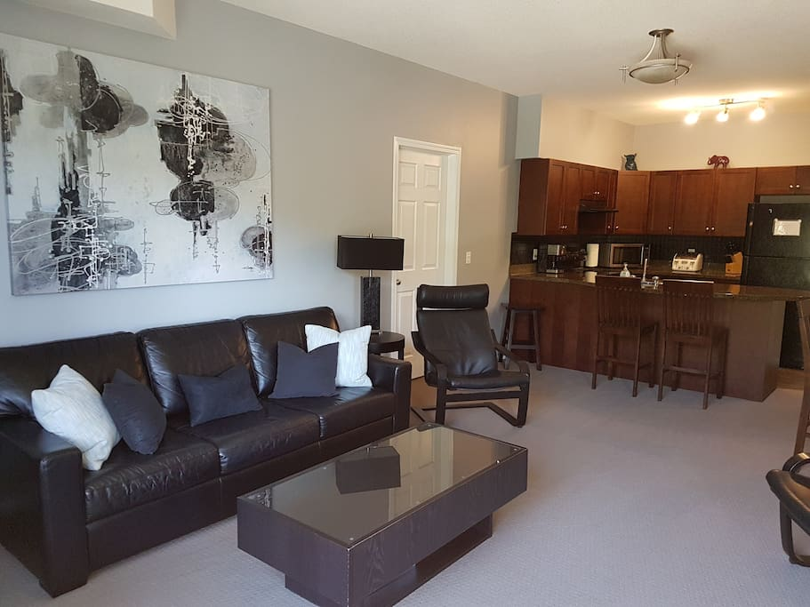 Open concept living room and kitchen with each bedroom located on either side of unit