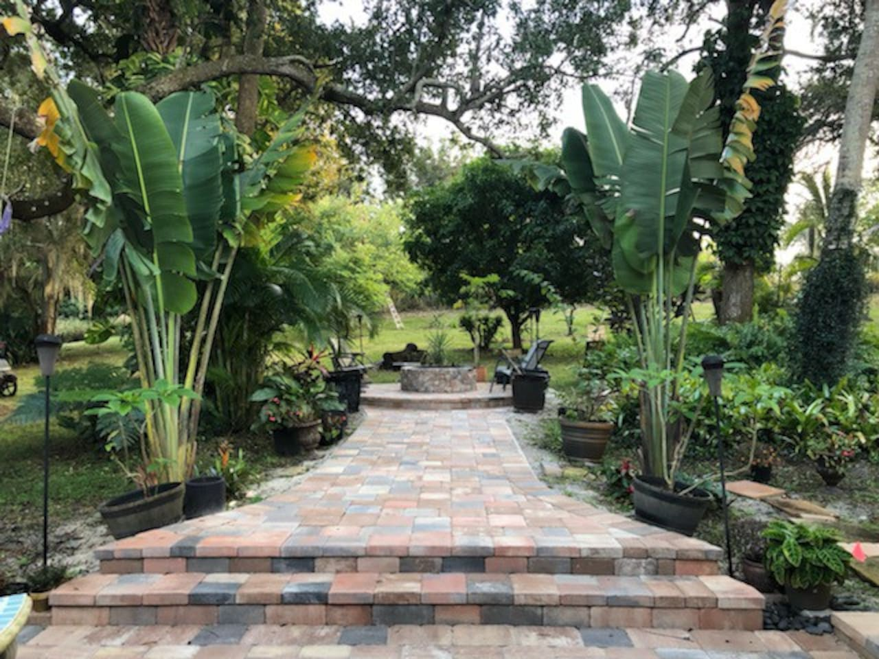 NEW, AMAZING Outdoor Living Space! BEAUTIFUL multi-level paver patio with large Fire-pit and grill for friends & family evenings surrounded by nature.