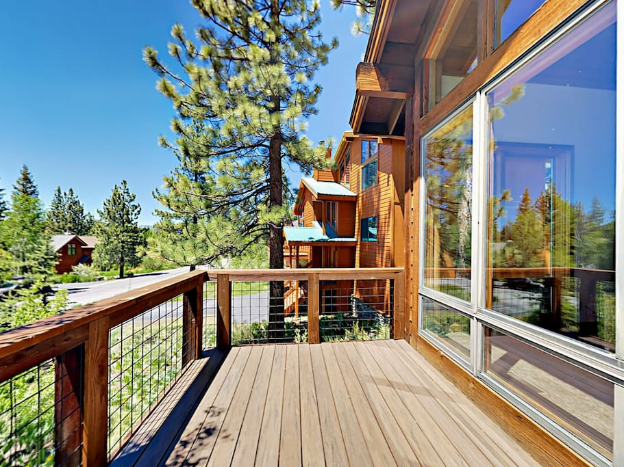 A private deck provides a pleasant spot to relax amidst the surrounding forest.