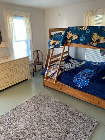 Children's room can sleep 3 with trundle bed pulled out.  Child locks on windows