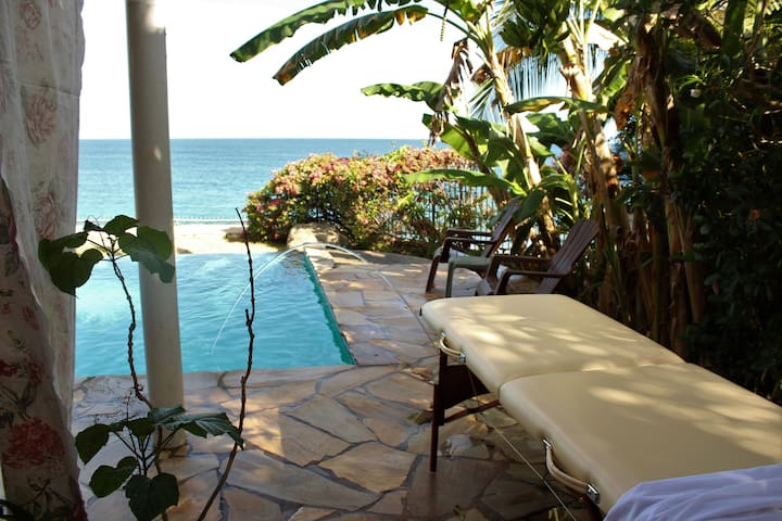 private massage on the pool deck over looking Caribbean ocean.