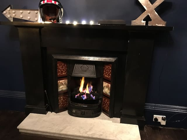 Curl up by the gas fire with a cup of tea.