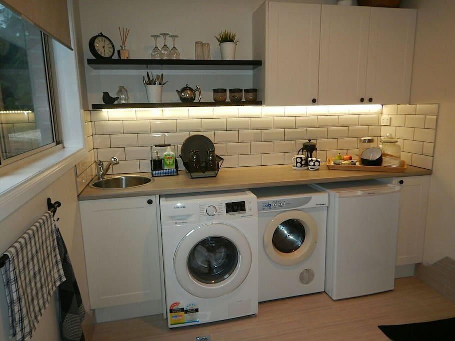 kitchenette with bar fridge, microwave, toaster and kettle