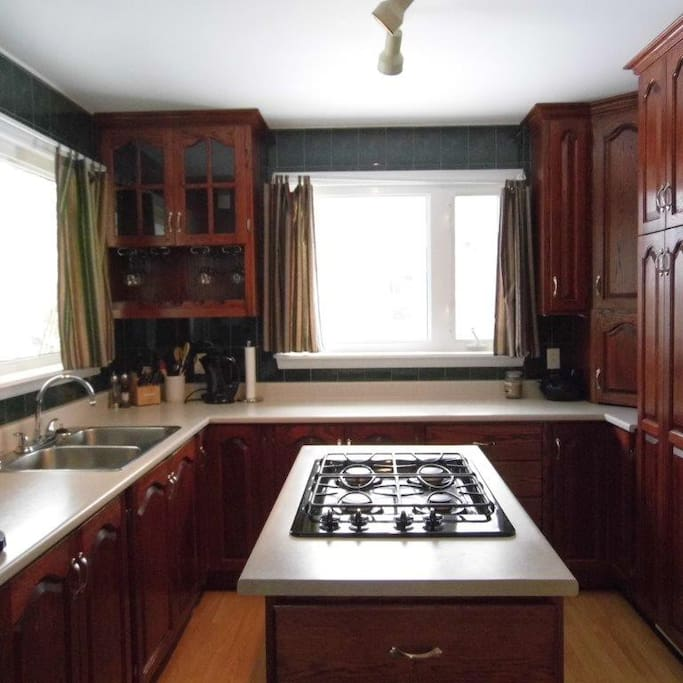 Large Kitchen with island and gas stove.
