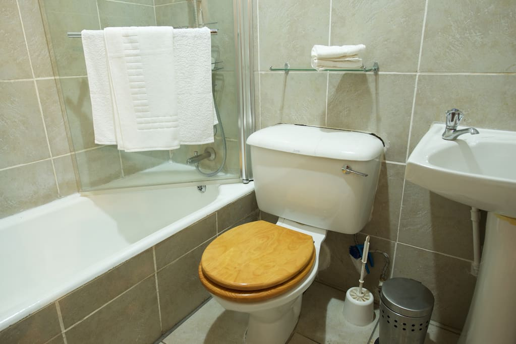 Separate bathroom featuring bath with shower head