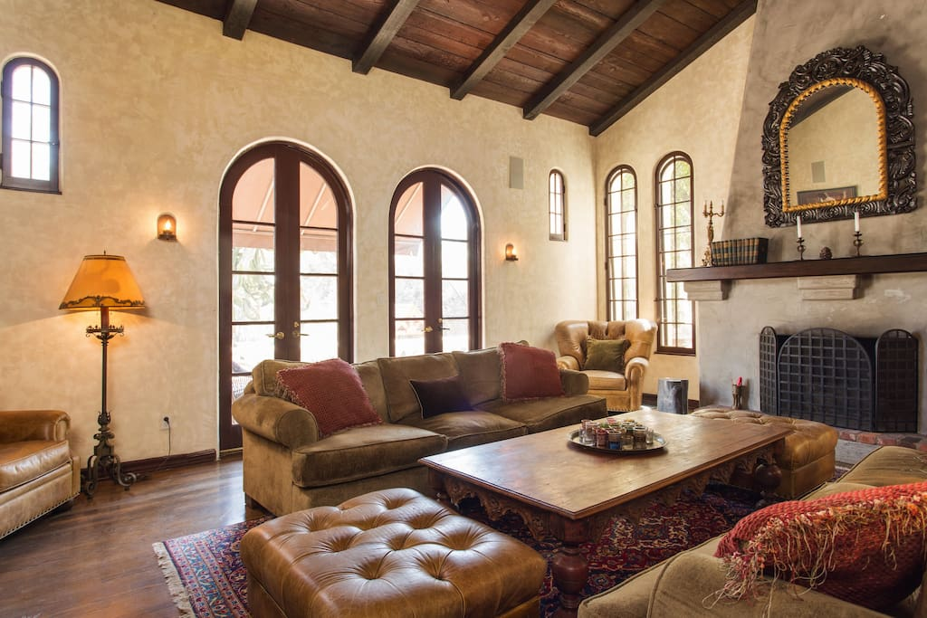 The home has an old-world, Moroccan influenced interior design with rich decor.