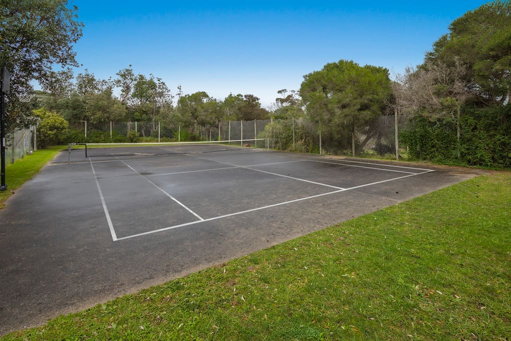 Shared Tennis Court & Basketball Ring