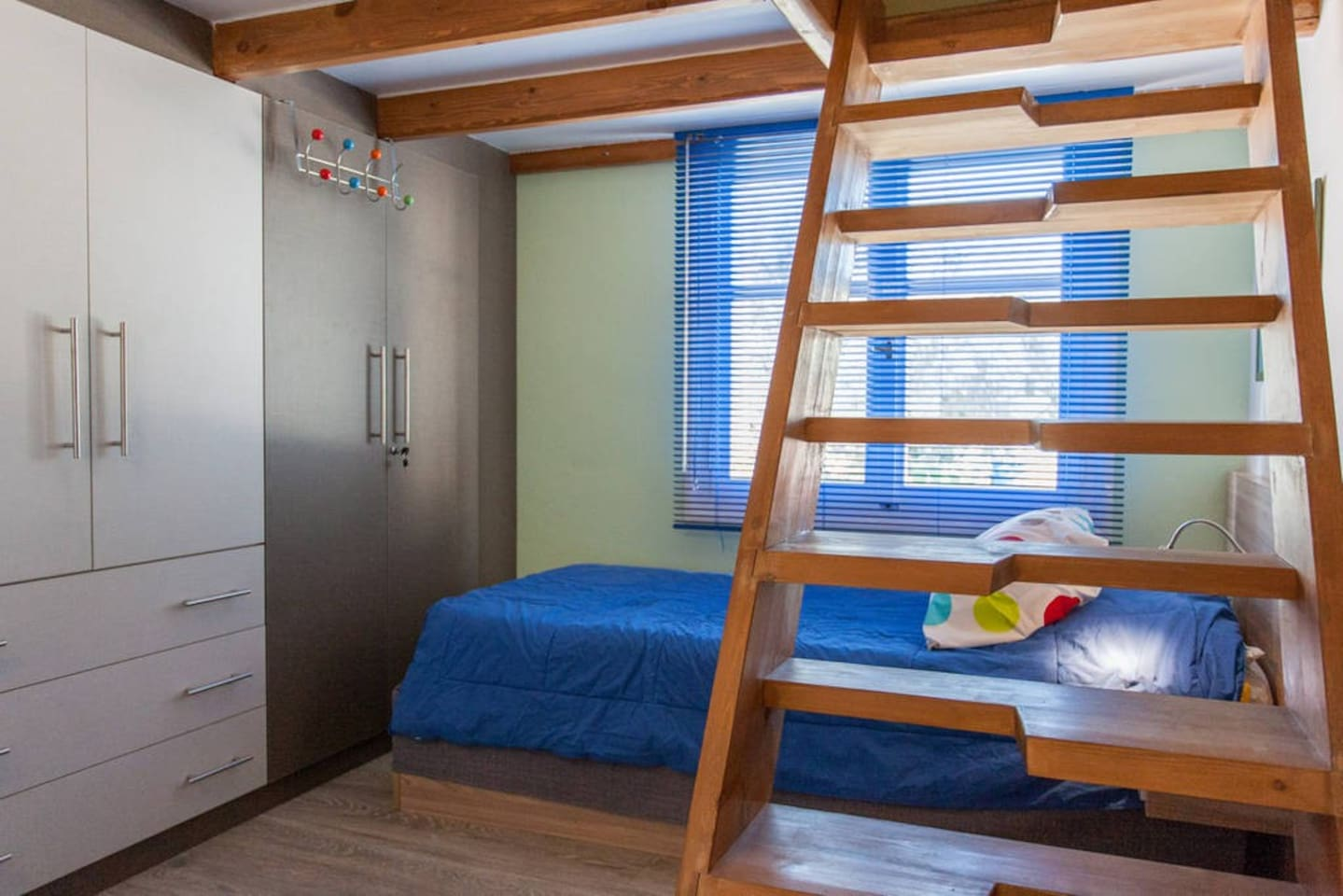 bedroom with wardrobe, single bed 90X200, staircase to the loft