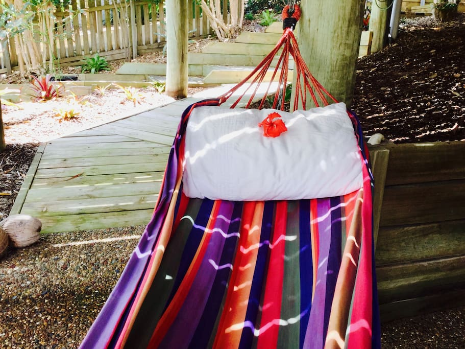 Relax on the hammock over the tropical garden