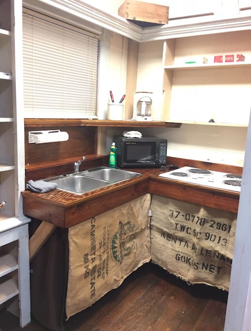 Private kitchenette with microwave, cooktop, coffee pot & mini fridge.