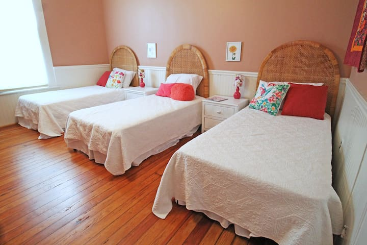Downstairs bedroom, The Flamingo Room, has that relaxed Gulf Coast vibe.