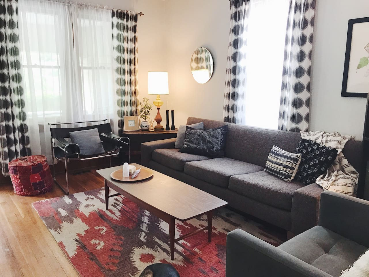 Eclectic mid century and modern furnishing in the living room make for a relaxing sitting and TV-watching space.