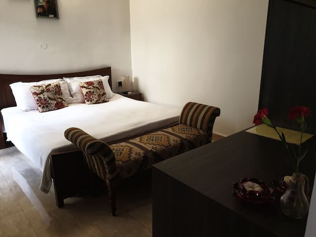 Air conditioned bed room with an ensuit bathroom. All essential linen and towels provided with additional free cleaning services