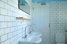Trendy metro tiles and twin sinks in the modern bathroom