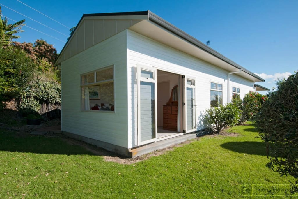 Main 3 bedroom house featuring 1 king bed, 2 bedrooms with 2 single beds each