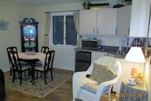 """Kitchenette and dining/worktop area.  Emphasis on the """"ette"""" part of Kitchen.  This is not for preparing big meals...we want everyone to relax while they are here, even the cook!"""