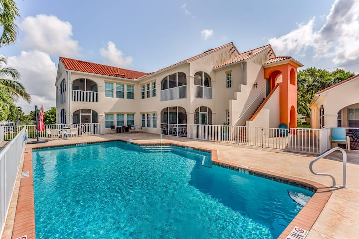 Colorful canal front condo w/shared pool, river views & dog-friendly!