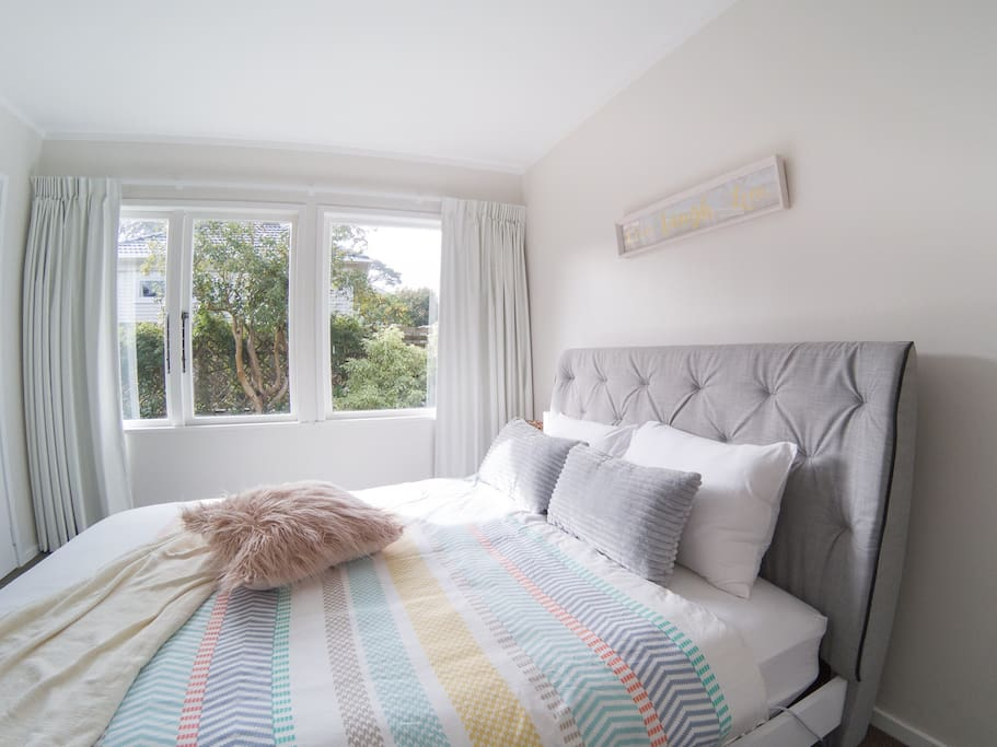 Your bedroom with comfy queen bed and garden view