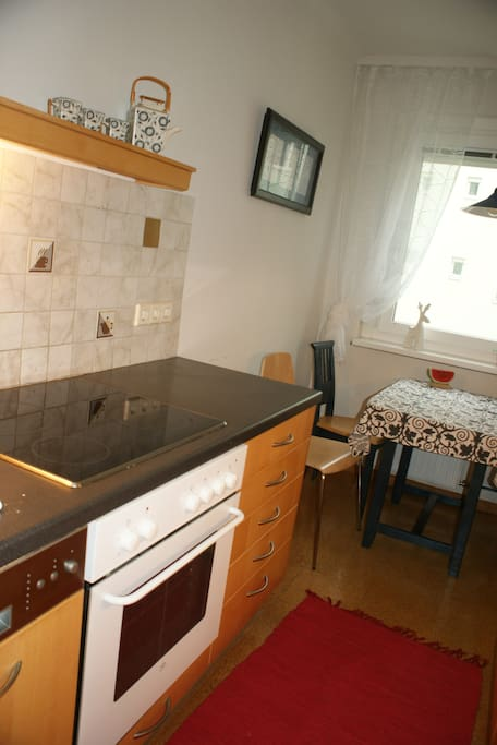 Fully furnished kitchen with oven and dishwasher