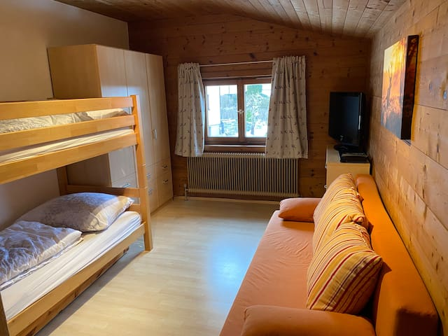 2 nd bedroom with bunk beds and double sofa bed. Wardrobe, TV, DVD player and on suit bathroom (toilet, sink and shower).