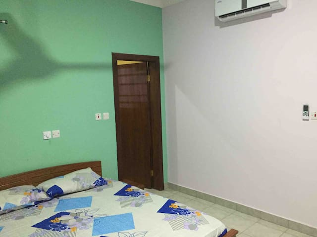 Master bedroom comes with queen size bed with side drawers, air-conditioning for guest comfort.