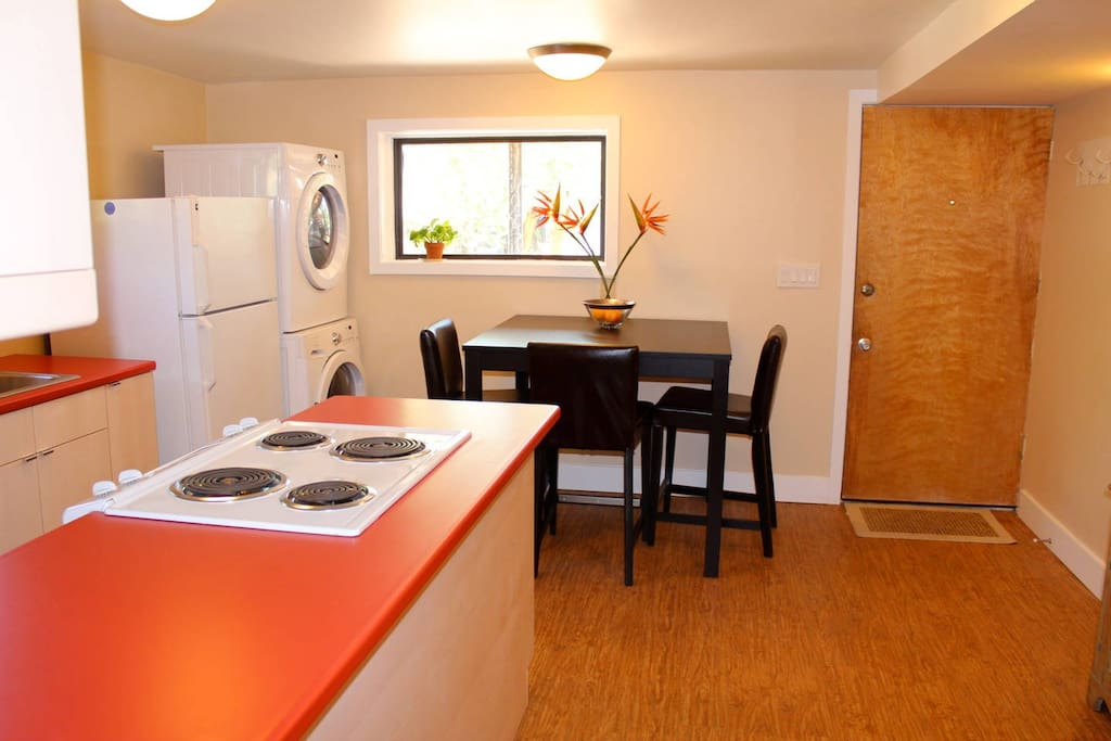 Bright, sunny, welcoming kitchen and common area.