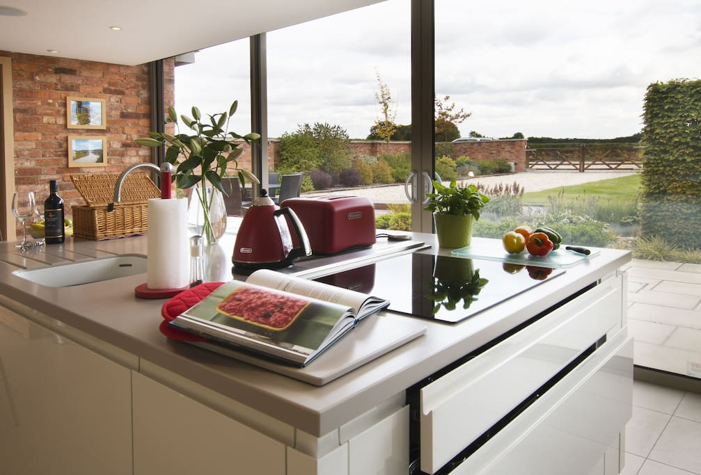 Ground floor:  Stunning kitchen with exposed brick and stone work and patio doors providing light and views of the grounds