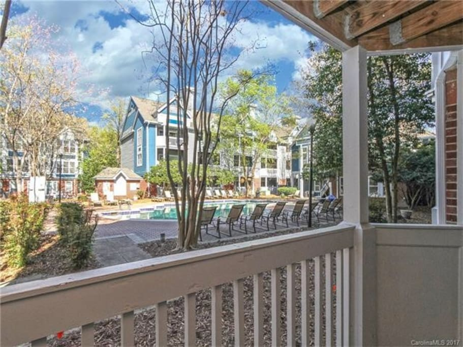 Large balcony with patio seating overlooking pool in the heart of Uptown Charlotte