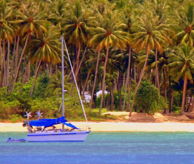 Surfmachine at anchor in Lagundri Bay on the island of Nias on the west coast of Sumatra in the Indian Ocean.