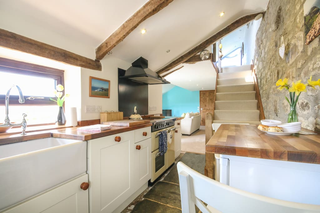 Heated slate floor, Oak beams and views over the fields make this a great place to cook up storm even if its calm and sunny outside!
