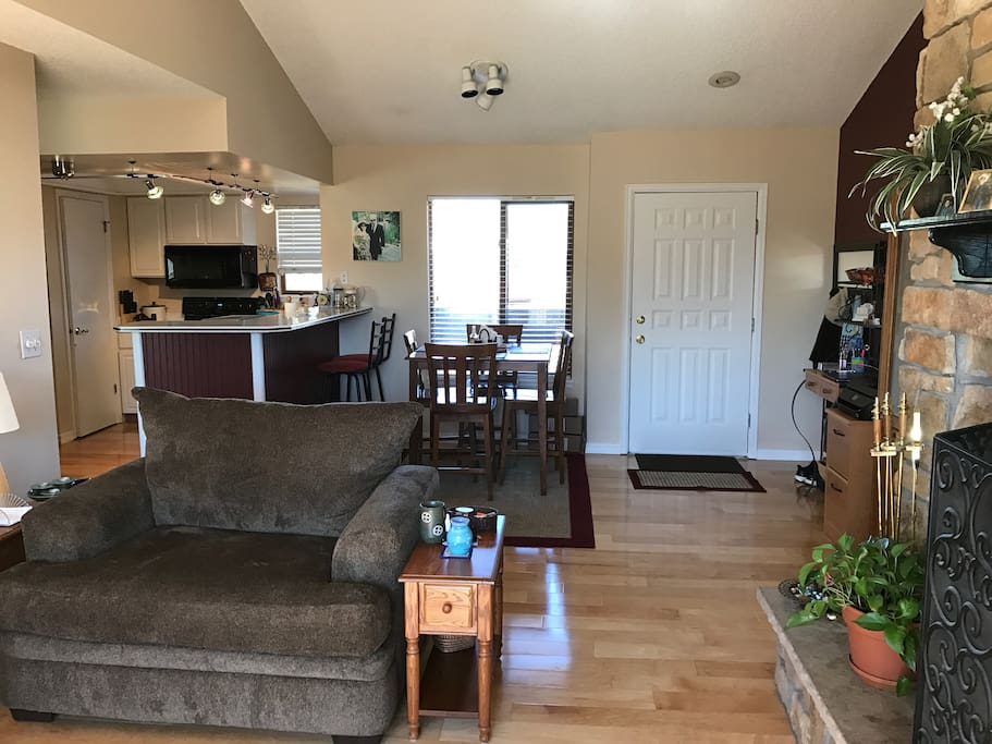 Opposite view of living room, looking into kitchen.