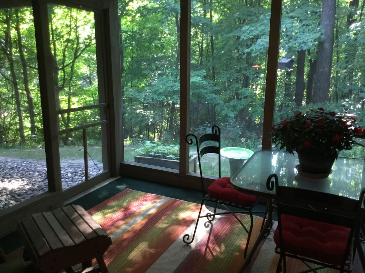 Screened porch, peaceful and relaxing setting.