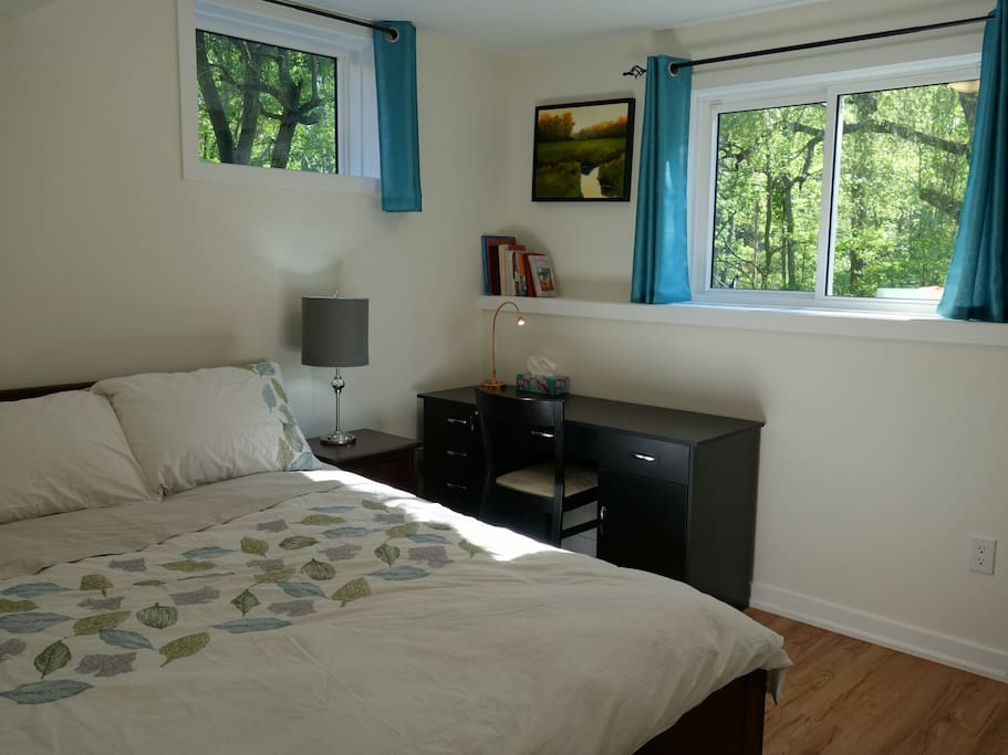 Peaceful forest view from EVERY window in the house.  Plush bedding, 100% cotton luxury sheets, full closet. The bedroom is a queen-size very comfortable mattress, and there are four large storage drawers in the wooden bed. Desk has many drawers, a cupboard, and desk lamp.