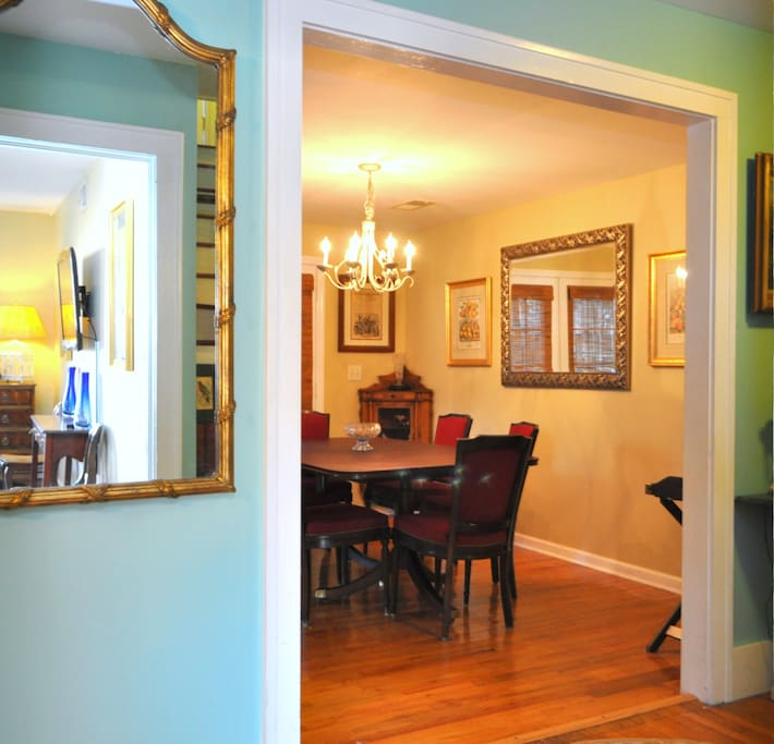 Dining room from stairwell hall. Large full length mirror- great for getting ready at night.
