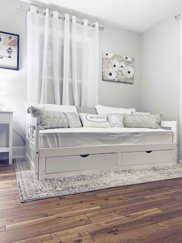 First bedroom • Day bed that pulls out into a king size bed • Storage drawers underneath bed • Full  closet • Original built in also available for use
