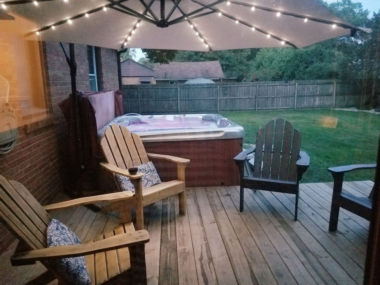 Hot tub and solar lit awning. Privacy fenced backyard.  Adirondack chairs for your enjoyment during warmer months.