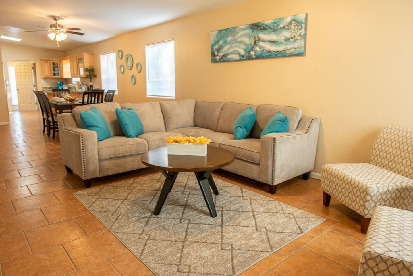 Open floorplan with spacious living and dining room. Sitting room for 8