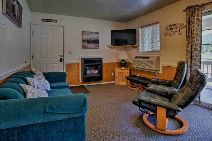 Cozy living room with reclining chairs, sofa for two. Take in a movie or enjoy the Wi-Fi.