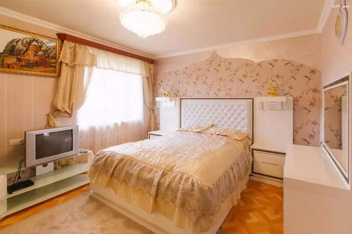 Comfortable bedroom with king bed and balcony