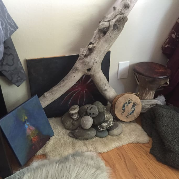 My own artwork decorates the space, with rocks and shells from local beaches