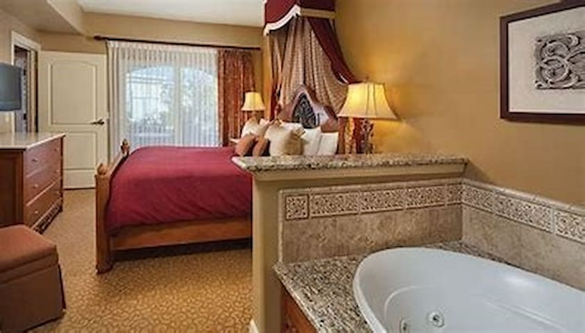 The interior has been updated, but still includes a king bed, TV, and large jacuzzi tub, plus access to your private balcony from the bedroom.