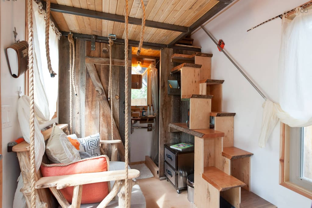 Stairs lead to upstairs sleeping loft with a queen bed.