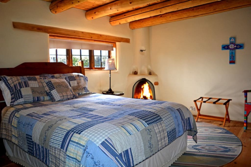 Bedroom #2 with gas log fireplace, Queen bed and directly neighboring tub only bathroom
