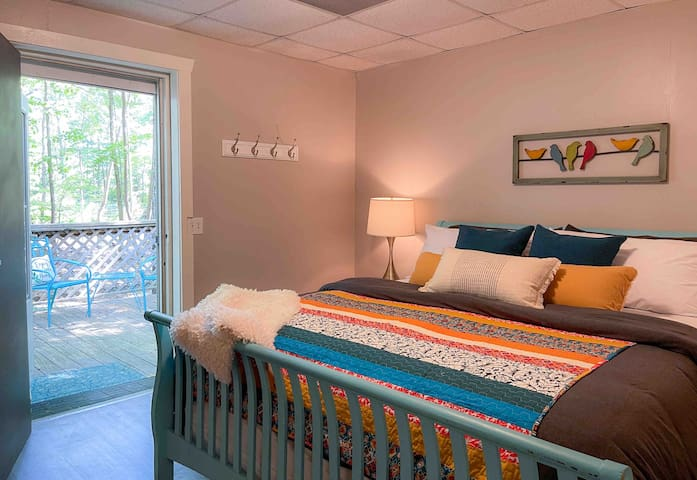 """The master suite features a comfy king-size bed, 50"""" HDTV with house Netflix account, plus a private deck, and large walk-in closet with laundry. Close all the doors for a perfectly dark bedroom so you can sleep in or grab a nap!"""