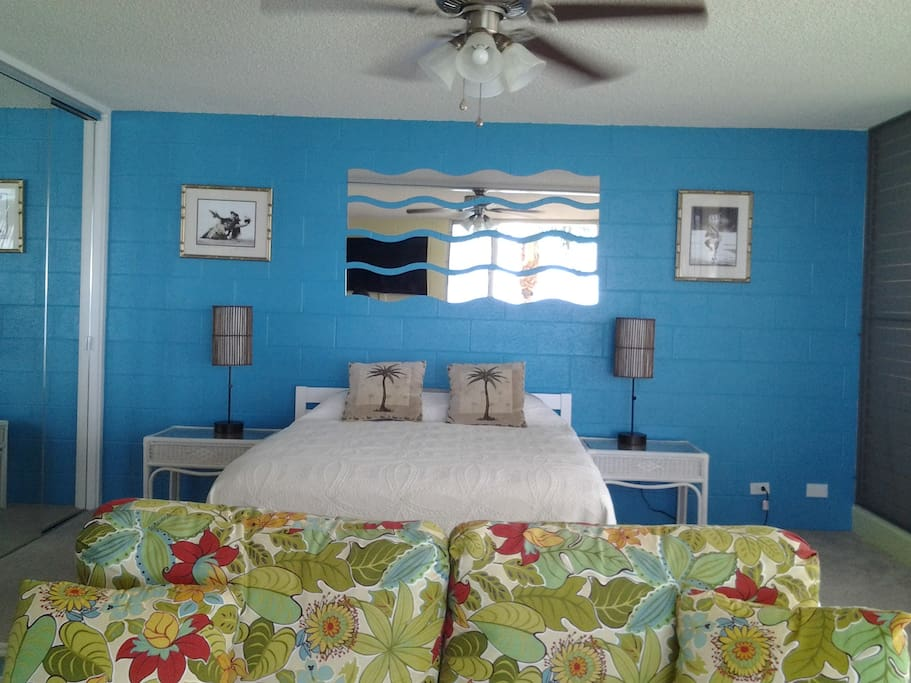 Open 1-BR layout. Removed wall opens the bedroom to ocean views. Memory foam mattress.