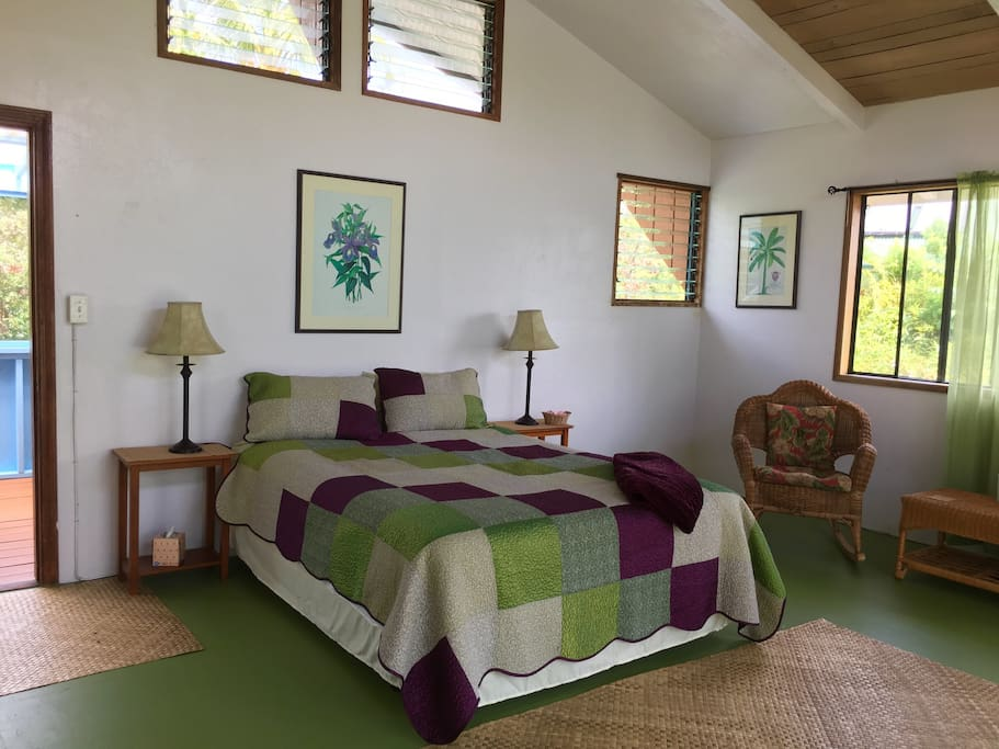 The bedroom has entire floor. We have a sitting porch, and a balcony overlooking the ocean!  A queen sized bed. And sitting area for friends!