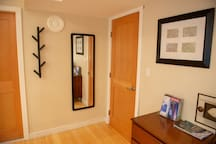 Full length mirror, locking door for privacy and a coat hook.