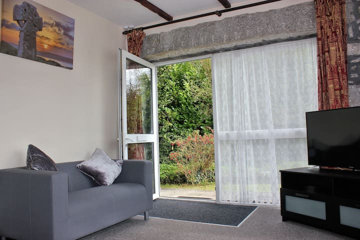 Step from the lounge directly in to the leafy garden, or just open the door and enjoy the fresh country air