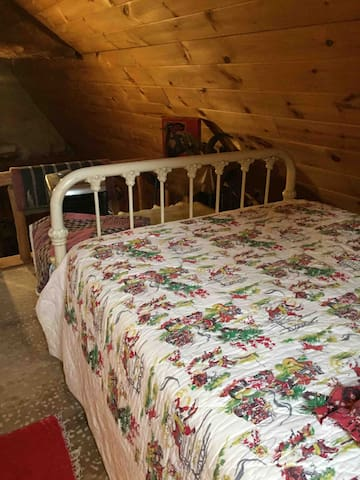 Double bed in loft area.