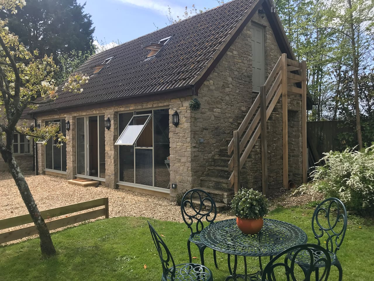 The loft sits above our two studios access is separate up the stone stairway separate private parking and gated entrance. lovely space  small double bed private bathroom  and shower Excellent if working nearby or studying at the Cotswold Airport